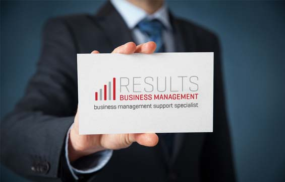 Results Business Management home page pic of financial management officer holding business card out close to camera.